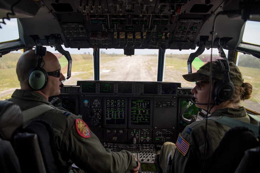 Capt. Jason Rimmer and Capt. Leesa Froelich, pilots assigned to the 815th Airlift Squadron, Keesler Air Force Base, Mississippi, fly a C-130J Hercules for an airdrop of Royal Australian Air Force combat controllers assigned to the 4th Squadron, Bravo flight, during Exercise Cope North 20, Feb. 14, 2020, Andersen Air Force Base, Guam. Cope North 20 is an annual trilateral field training exercise conducted at Andersen Air Force Base, Guam, and around the Commonwealth of the Northern Mariana Islands (CNMI), Palau and Yap in the Federated States of Micronesia. (U.S. Air Force photo by Senior Airman Gracie Lee)