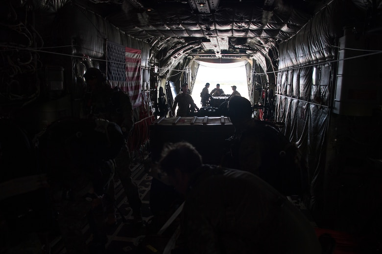 Aircrew members assigned to the 815th Airlift Squadron, Keesler Air Force Base, Mississippi, prepare to fly a C-130J Super Hercules for an airdrop of Royal Australian Air Force combat controllers assigned to the 4th Squadron, Bravo flight, during Exercise Cope North 20, Feb. 14, 2020, Andersen Air Force Base, Guam. Cope North 20 is an annual trilateral field training exercise conducted at Andersen Air Force Base, Guam, and around the Commonwealth of the Northern Mariana Islands (CNMI), Palau and Yap in the Federated States of Micronesia. (U.S. Air Force photo by Senior Airman Gracie Lee)