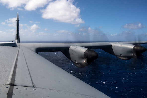 A C-130J Super Hercules flies over the Pacific Ocean for an airdrop of container delivery systems over Tinian during Exercise Cope North 20, Feb. 24, 2020, Andersen Air Force Base, Guam. Cope North 20 is an annual trilateral field training exercise conducted at Andersen Air Force Base, Guam, and around the Commonwealth of the Northern Mariana Islands (CNMI), Palau and Yap in the Federated States of Micronesia. (U.S. Air Force photo by Senior Airman Gracie Lee)