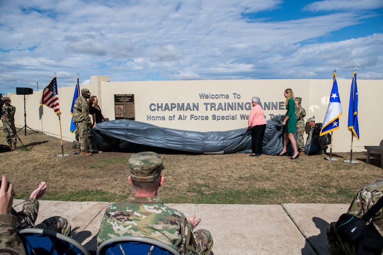 Chief Master Sgt. of the Air Force Kaleth O. Wright (left) and Chief Master Sgt. Julie Gudgel (right), along with the family of Master Sgt. John A. Chapman (center), reveal the new sign during the Joint Base San Antonio Annex renaming ceremony, March 4, 2020, at Joint Base San Antonio-Chapman Annex, Texas. Joint Base San Antonio-Annex, home of Special Warfare training, is renamed JBSA-Chapman Annex in honor of the service, heroism, and ultimate sacrifice of Master Sgt. John A. Chapman. Chapman was posthumously awarded the Medal of Honor for his action in Takur Ghar, Afghanistan. (U.S. Air Force photo by Sarayuth Pinthong)