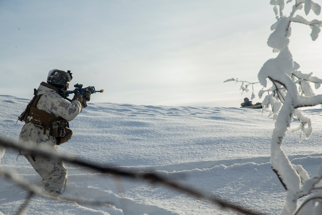 A U.S. Marine fires at a notional enemy during exercise Snow Panzer in Setermoen, Norway, Feb. 25.