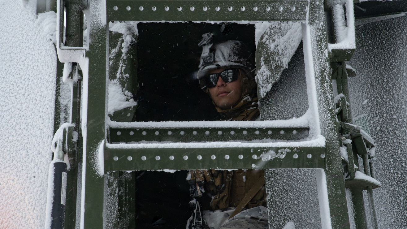 A U.S. Marine rides in a Medium Tactical Vehicle Replacement during a cold-weather training package in preparation of Exercise Cold Response 20, in Bjerkvik, Norway, Feb. 26.