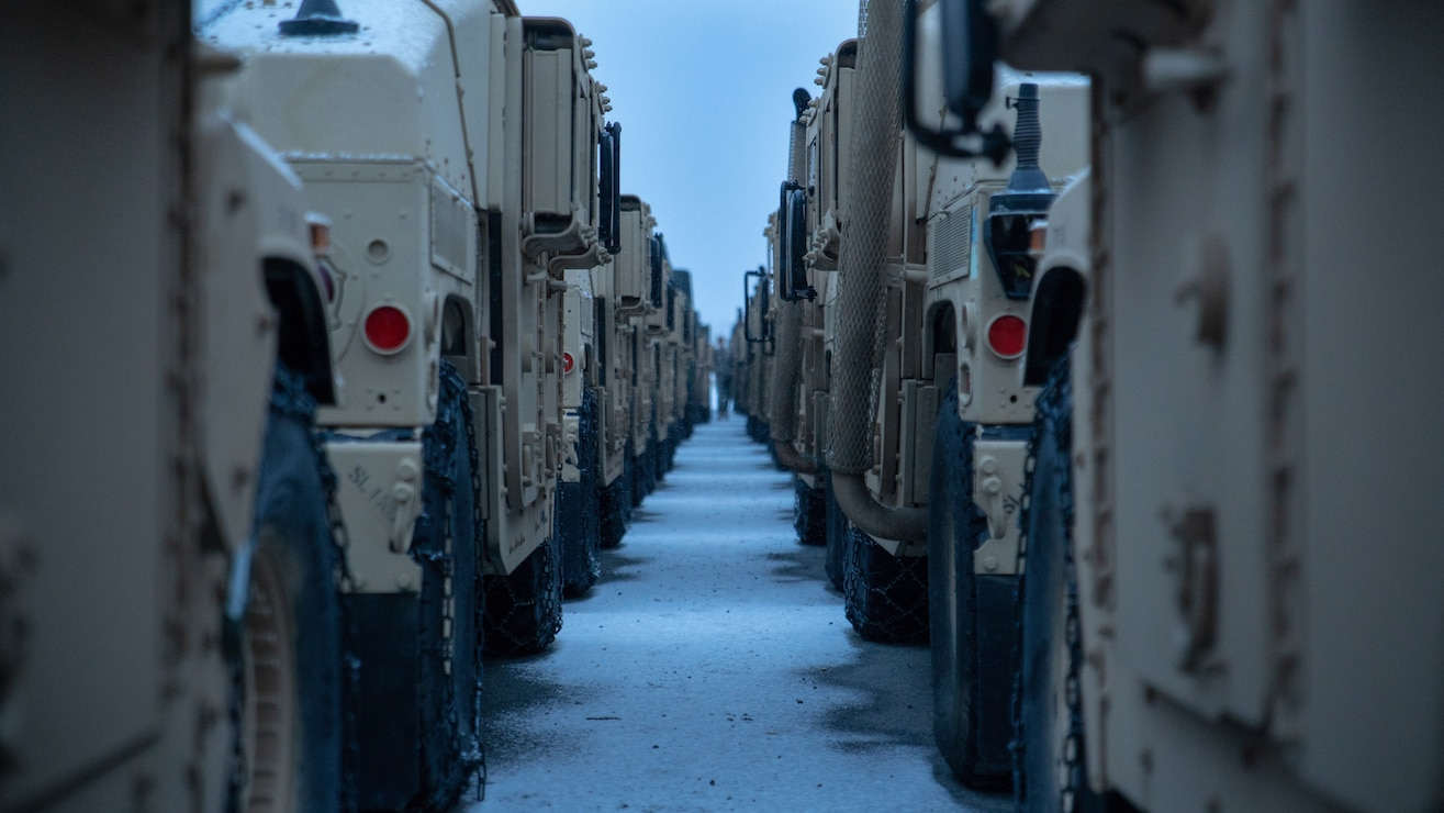 U.S. Marine Corps High Mobility Multipurpose Wheeled Vehicles from the MCPP-N caves are staged at Vӕrnes, Norway, Feb. 13.