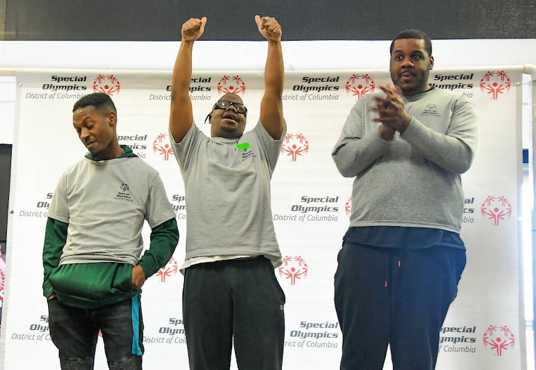 Lenny Haynes, Ellery Roberts, and Cervante Givens, participants on the Special Olympics DC Adult Bowling Tournament, celebrate their success during the tournaments award ceremony in Hyattsville, Md., March 4, 2020. The Special Olympics DC holds a 3-day-long adult bowling tournament each year for disabled adults. (U.S. Air Force photo/Senior Airman Jalene A. Brooks)