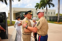 Marine Sgt. Maj. Bryan K Zickefoose, the Command Senior Enlisted Leader of U.S. Southern Command, greets Colombia's Chief of Defense Gen. Luis Navarro Jiménez.