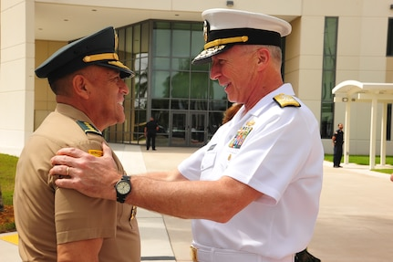 Navy Adm. Craig Faller, the Commander of U.S. Southern Command, greets Colombia's Chief of Defense Maj. Gen. Luis Navarro Jiménez .