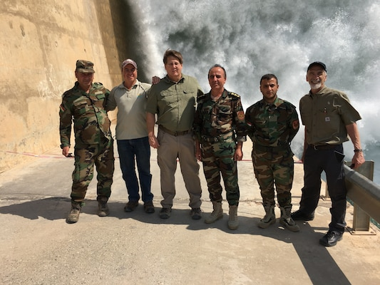 The Scientific / Technical Award of Excellence recognized the Mosul Dam Bottom Outlet Plunge Pool, a team effort led by Mr. Mike Phillips from IWR's Risk Management Center (RMC).  Shown here are Mike Phillips and Bill Empson with Sal Todaro and the Iraqis at the Mosul Dam, Iraq (2019)