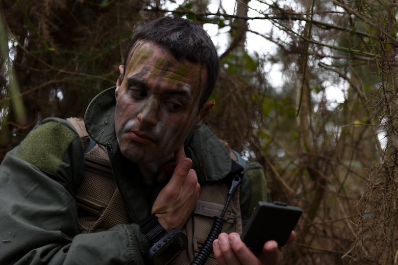 A 48th Fighter Wing Airman applies camouflage face paint during a Survival, Evasion, Resistance, and Escape training course at Stanford Training Area near Thetford, England, March 4, 2020. Camouflage face paint allows class participants to blend into their surroundings which is critical when evading capture. (U.S. Air Force photo by Airman 1st Class Rhonda Smith)