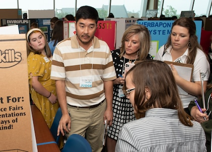 Scientists and engineers from Naval Surface Warfare Center Panama City Division (NSWC PCD) and personnel from other organizations served as judges for this year's Invention Convention. Allie Williams, right, serves as an engineer at NSWC PCD