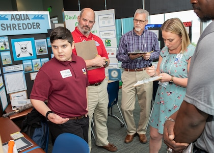 Scientists and engineers from Naval Surface Warfare Center Panama City Division (NSWC PCD) and personnel from other organizations served as judges for this year's Invention Convention. Darryl Updegrove, back right, serves as a branch head at NSWC PCD.