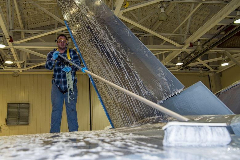 Andrew Sarillana, Shiloh Services Incorporated aircraft wash contractor with the 1st Maintenance Group, washes a U.S. Air Force F-22 Raptor at Joint Base Langley-Eustis, Virginia, Dec 12, 2019.