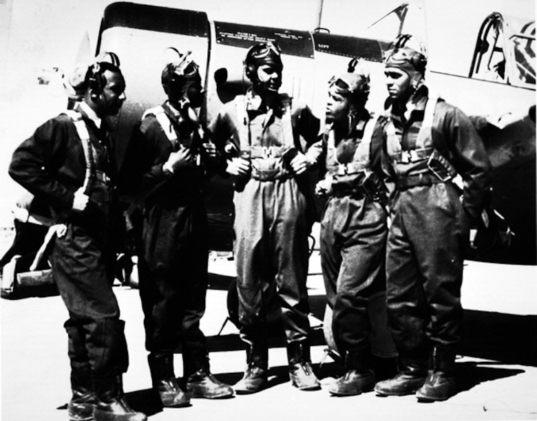 In 1941 the first group of black cadets to earn their wings at Tuskegee Army Air Field gather alongside a Vultee BT-13 trainer. Benjamin O. Davis Jr. (middle) became the first black general in the U.S. Air Force in 1954. (From the Smithsonian Institution, ID #99-15437)