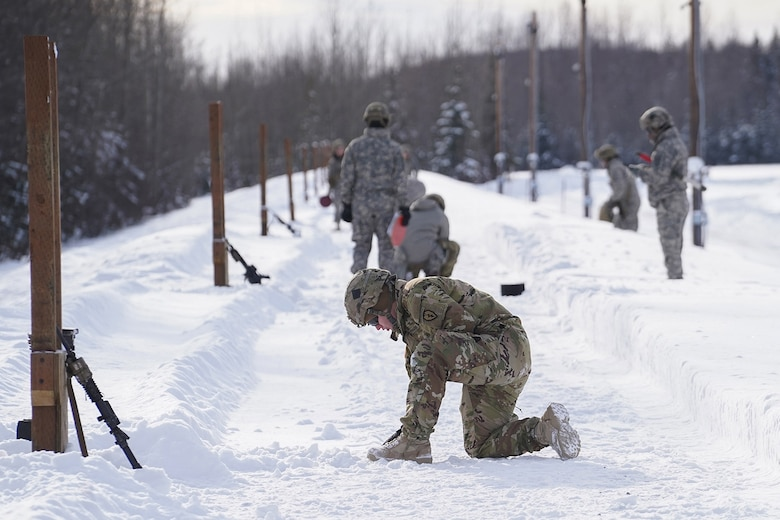 Paratroopers assigned to 1st Battalion, 501st Parachute Infantry Regiment, 4th Infantry Brigade Combat Team (Airborne), 25th Infantry Division, U.S. Army Alaska, qualify with M-4 carbines on Joint Base Elmendorf-Richardson, Alaska, March 3, 2020.