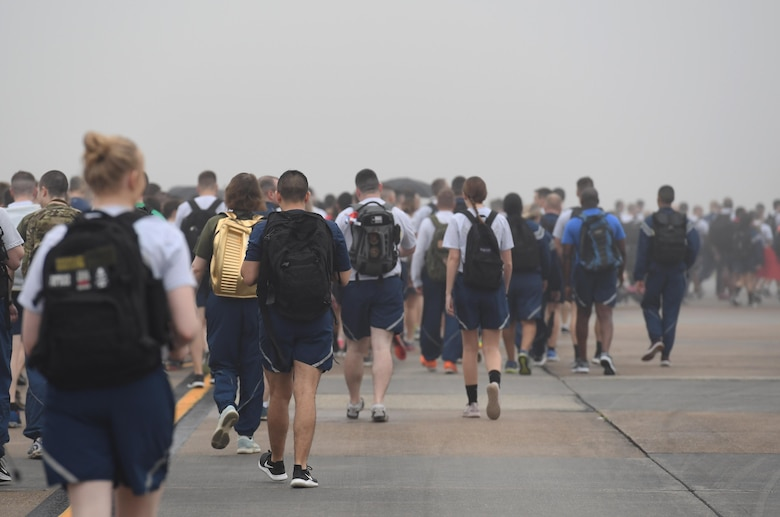 Keesler personnel participate in the Dragons March Fourth ruck march on the flightline at Keesler Air Force Base, Mississippi, March 4, 2020. Keesler personnel carried backpacks during the three-mile walk which symbolized the weight one carries through life. (U.S. Air Force photo by Kemberly Groue)