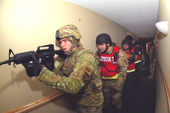 "(Left to right) James Weston, Fire and Emergency Services rescue captain, assists Airman 1st Class Gabriel Briones, F&ES firefighter, as he gears up in ballistic protective and medical response gear during a Rescue Task Force exercise Dec. 5, 2019, at Hill Air Force Base, Utah. The RTF is a tactic used during active shooter/hostile events and consists of ""task forces"" or integrated teams of security forces defenders and fire and emergency medical services responders working together to provide medical care to victims during an incident much faster. (U.S. Air Force photo by Todd Cromar)"