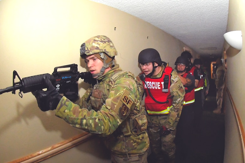 "First responders clear a building during a Rescue Task Force exercise Dec. 5, 2019, at Hill Air Force Base, Utah. The RTF is a tactic used during active shooter/hostile events and consists of ""task forces"" or integrated teams of security forces defenders and fire and emergency medical services responders working together to provide medical care to victims during an incident much faster. (U.S. Air Force photo by Todd Cromar)"