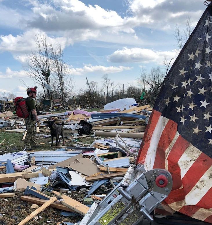 Master Sgt. Rudy Parsons, a pararescueman in the Kentucky Air National Guard's 123rd Special Tactics Squadron, searches debris fields with Callie, his search-and-rescue dog, in Cookeville, Tenn., March 3, 2019. Parsons and Callie searched for survivors of the multiple tornadoes that hit middle Tennessee earlier that morning, claiming 24 lives. Parsons and Callie — the only certified search-and-rescue dog in the Department of Defense — covered approximate one square mile in five hours. The Dutch shepherd is able to clear rubble piles in minutes using her keen sense of smell, saving hours or days over traditional search-and-rescue methods. (Courtesy Photo)