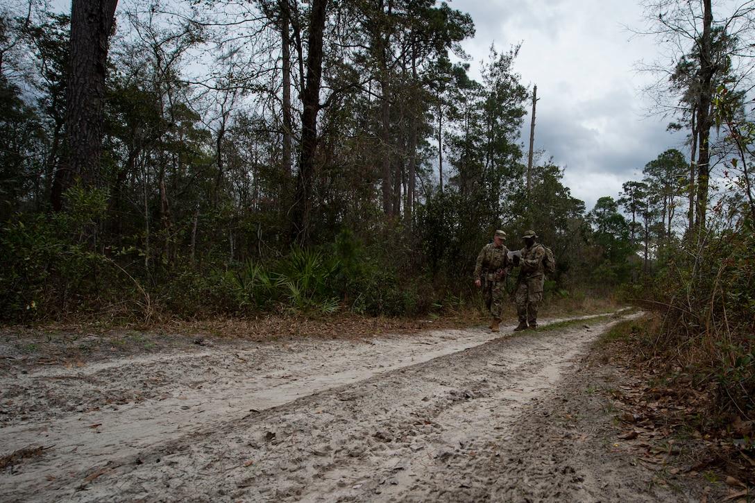 Photo of Airmen walking to a waypoint during land navigation training.