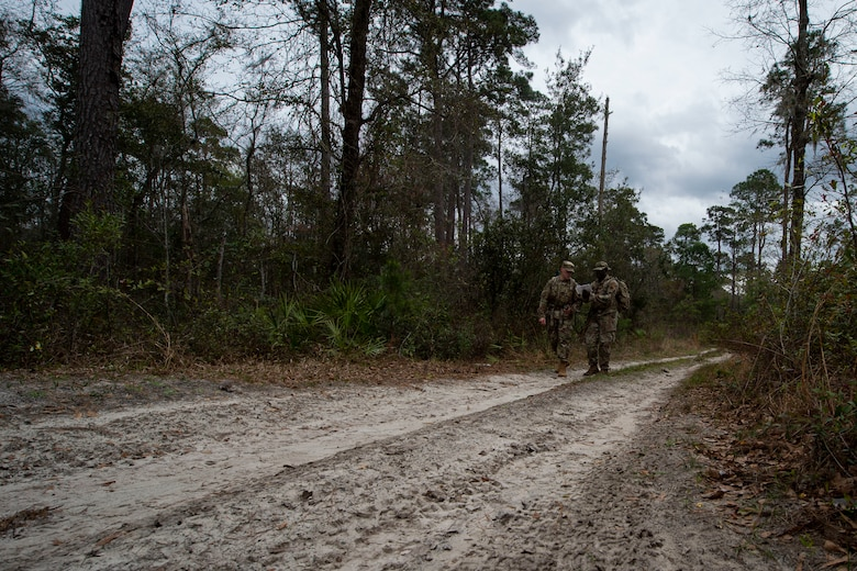 Photo of Airmen walking to a waypoint during land navigation training.