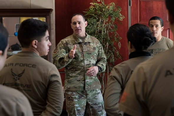 A senior enlisted member speaks to a group.