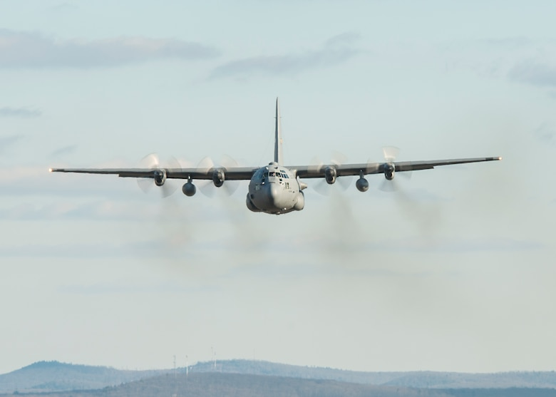 A C-130H Hercules assigned to the 103rd Airlift Wing flies over western Massachusetts, Jan. 15, 2020. Aircrews from the 103rd flew a two-ship formation and conducted airdrops with heavy pallets and container delivery systems, training key tactical airlift capabilities. (U.S. Air National Guard photo by Staff Sgt. Steven Tucker)