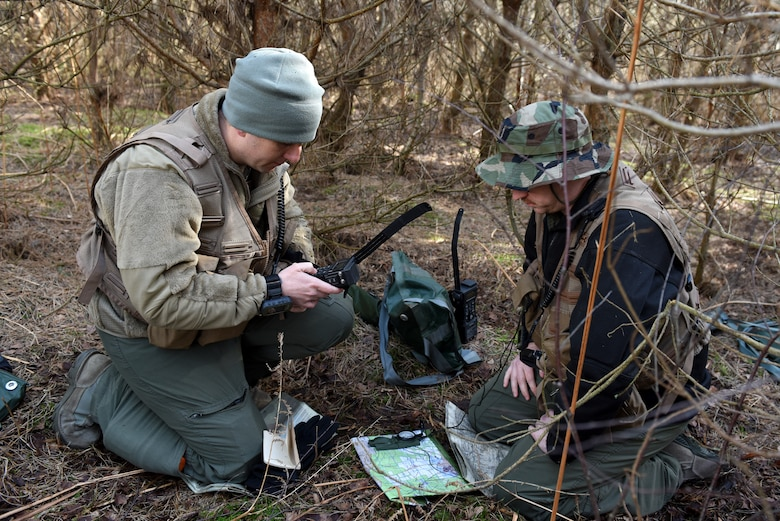 A 48th Fighter Wing Airman uses a compass during a Survival, Evasion, Resistance, and Escape training course at Stanford Training Area near Thetford, England, March 4, 2020. U.S. Air Force aircrews are required to re-accomplish this training every three years to maintain vital skills to survive in case of crashing behind enemy lines. (U.S. Air Force photo by Airman 1st Class Rhonda Smith)