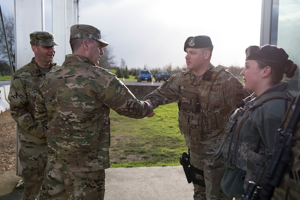 U.S. Air Force Maj. Gen. John Wood, Third Air Force commander, greets Tech. Sgt. David Gajeske, 423rd Security Forces Squadron flight sergeant, during a tour at the RAF Alconbury main gate, England, March 3, 2020. Wood and Chief Master Sgt. Randy Kwiatkowski, Third Air Force command chief, visited 501st Combat Support Wing Airmen and facilities and recognized outstanding performers in the wing. (U.S. Air Force photo by Airman 1st Class Jennifer Zima)