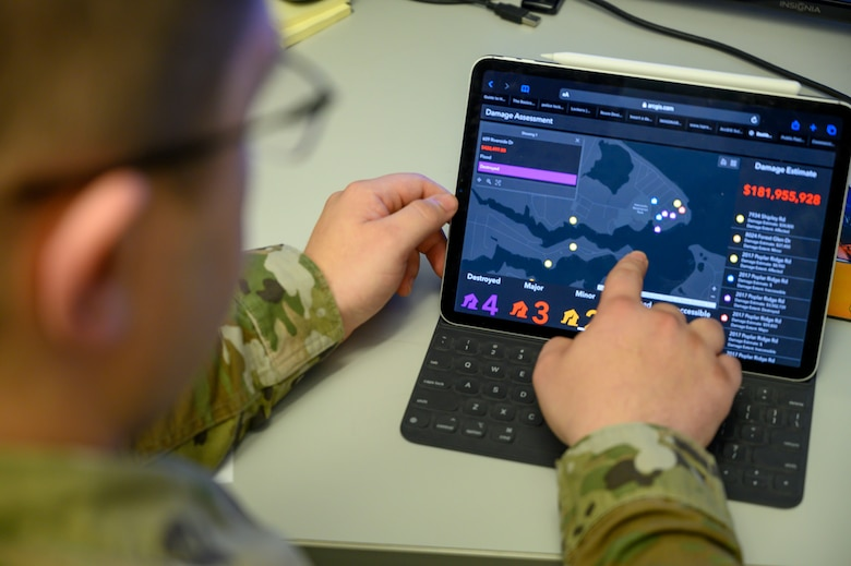 U.S. Air Force Master Sgt. Brandon Louderback, a 188th CES engineer assistant, Arkansas Air National Guard, demonstrates Geographic Information System (GIS) surveying capabilities during a training exercise March 4, 2020, at Ebbing Air National Guard base, Fort Smith, Ark. (U.S. Air National Guard photo by Staff Sgt. Matthew Matlock)