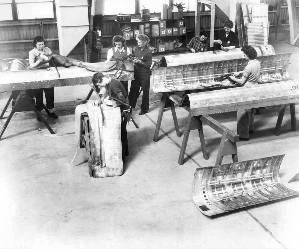 Women working on aircraft panels at Hill AFB during World War II.