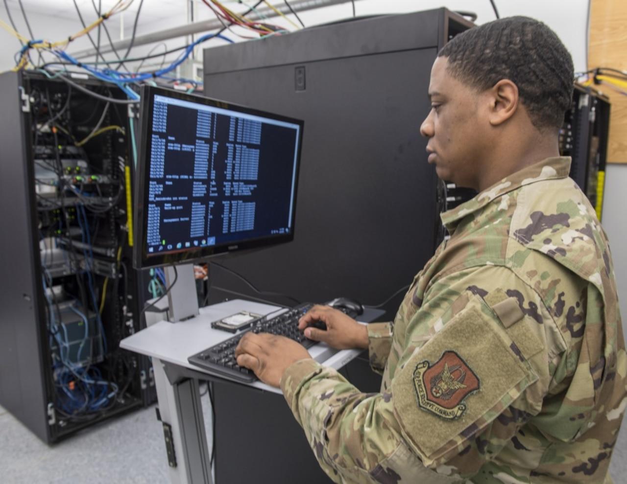 Service member monitors cyber threat.