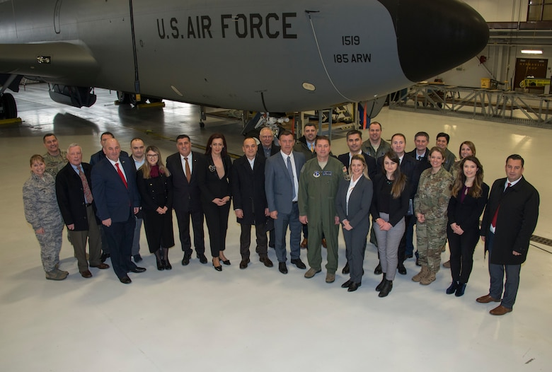 Nine mayors and other delegates from Kosovo stand in front of a KC-135 Statotanker, assigned to the 185th Air Refueling Wing, Iowa Air National Guard, at Colonel Bud Day Field in Sioux City, Iowa, Feb. 26, 2020. The group came to Iowa to formalize a sister-city agreement between the city of Gjilian and Sioux City as an outgrowth of the National Guard State Partnership Program. (U.S. Air National Guard photo by Senior Master Sgt. Vincent De Groot)