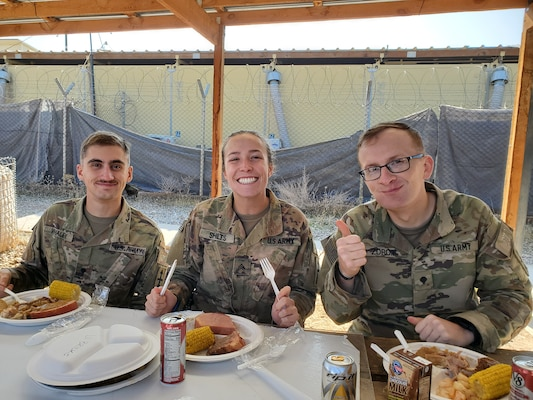 """Spc. Austin Whaley, a human resources specialist, Sgt. Emily Shilts, an intelligence analyst, and Spc. Dylan Zdroik, a signal information sergeant with the Wisconsin Army National Guard's 1st Battalion, 128th Infantry, enjoy a meal together in Afghanistan. The 1st Battalion, 128th Infantry deployed to Afghanistan in July 2019, and is acting as a """"Guardian Angel"""" security element for the 3rd Security Force Assistance Brigade."""