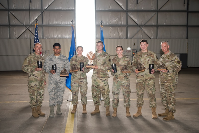 Medical technicians from Cannon Air Force Base, N.M., hold their trophies for second place at the 2019 Medic Rodeo closing ceremonies at Cannon Air Force Base, Sept. 20, 2019. Airman 1st Class Sinéad Brosnan, 27th Special Operations Healthcare Operations Squadron aerospace medical technician, led her team and lost only by a tenth of a point. (U.S. Air Force photo by Staff Sgt. Michael Washburn)