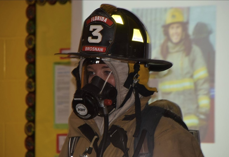 Airman 1st Class Sinéad Brosnan, 27th Special Operations Healthcare Operations Squadron aerospace medical technician, displays what she wears when responding to a fire during a school visit in Florida, New York, in 2016. Brosnan applied for a position with the New York City Fire Department and was told she had passed three days after swearing in to the Air Force. (Courtesy Photo)