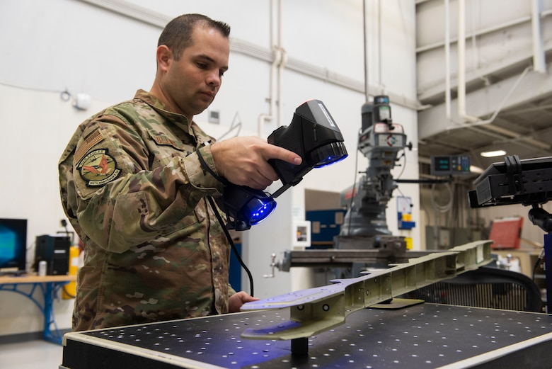 U.S. Air Force Tech. Sgt. Kevin Collins, 366th Maintenance Squadron aircraft metals technology section chief scans an aircraft structure, March 2, 2020, at Mountain Home Air Force Base, Idaho. The HandySCAN 3D allows Airmen to scan a structure, eliminating the need to hand draw it on the computer. (U.S. Air Force photo by Airman Natalie Rubenak)