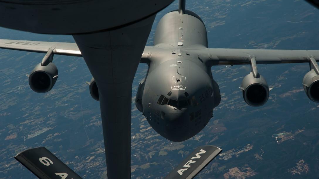 A C-17 Globemaster III approaches a KC-135 Stratotanker during an air refueling