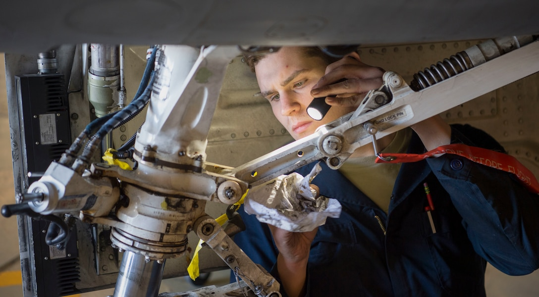 Airman helps with a phase inspection on an F-16 Fighting Falcon