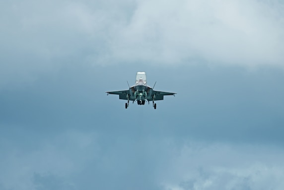 An F-35B Lightning II performs hover maneuvers at the Singapore Airshow