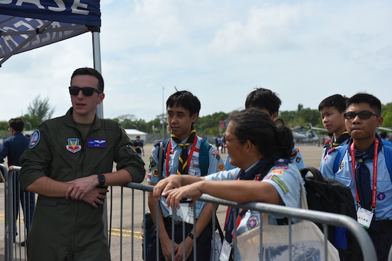 An MQ-9 Reaper pilot chats with Singapore Scouts at Singapore Airshow.