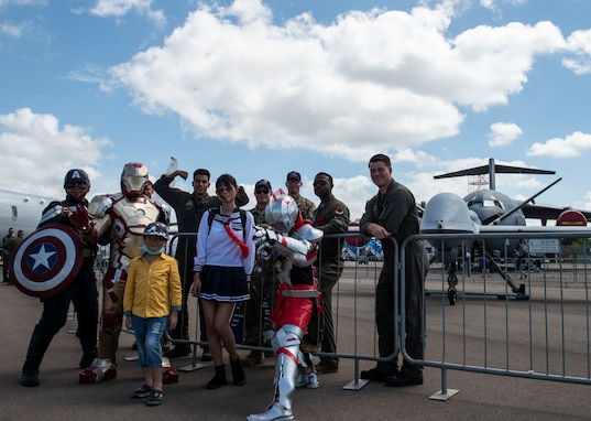 Airmen and Marines with UAS aircraft meet with Singapore Airshow guests.