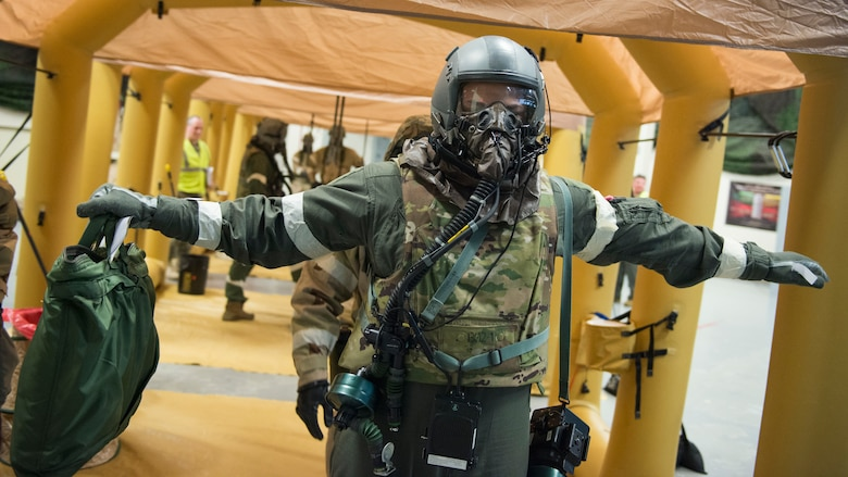 Tech. Sgt. Thomas Buckley, 118th Airlift Squadron loadmaster, is checked for contamination on his aircrew eye and respiratory protection system (AERPS) equipment during a large-scale readiness exercise at Bradley Air National Guard Base, East Granby, Conn. March 5, 2020. The exercise tested the 103rd Airlift Wing's ability to deploy to and sustain in a contested environment. (U.S. Air National Guard photo by Staff Sgt. Steven Tucker)