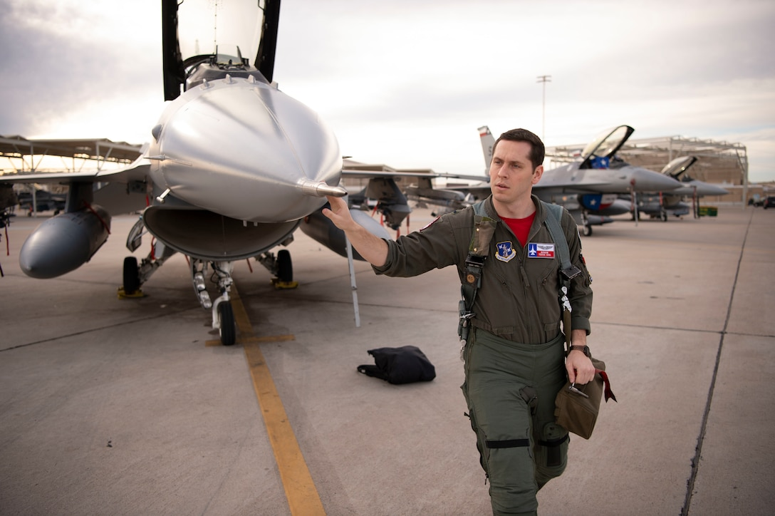 First Lt. James Demkowicz, a student F-16 pilot assigned to the 149th Fighter Wing, Air National Guard, conducts pre-flight checks prior to launch during Coronet Cactus, Feb. 28, 2020, at Luke Air Force Base, Ariz. The annual training event deploys members of the 149th FW, headquartered at Joint Base San Antonio-Lackland, Texas, to another environment in order to familiarize them with accomplishing mission objectives in an unfamiliar location. (Air National Guard photo by Staff Sgt. Derek Davis)