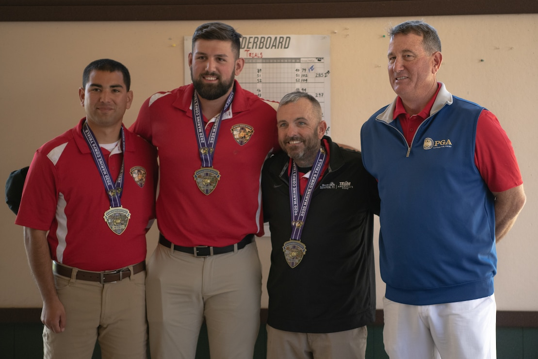 U.S. Marine Corps Staff Sgt.Eric Aragon (far left),and U.S. Marine Corps veterans Peter Lykins (center right) and Michael Sousadecarmo (center left) win the gold, silver and bronze medals, respectively, during the 2020 Marine Corps Trials golf tournament at Marine Corps Base Camp Pendleton, Calif., March 4. The Marine Corps Trials promotes recovery and rehabilitation through adaptive sports participation and develops camaraderie among recovering service members.