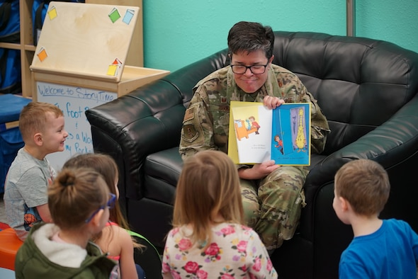 Col. Heather Cook, 319th Mission Support Group commander, reads a Dr. Suess book to a group of children March 4, 2020, in the library on Grand Forks Air Force Base, N.D. The story time took place following the library's grand re-opening ceremony, which celebrated its renovations to include new carpet, shelving, paint and signage. (U.S. Air Force photo by Senior Airman Elora J. McCutcheon)