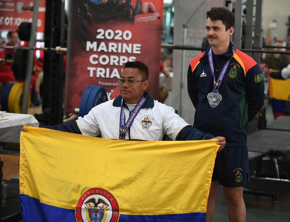 Columbian athlete Andres Salazar (left), and United Kingdom athlete Joe Durkin (right) win the gold and silver medal, respectively, in the 72.01Kg-80Kg weight class during the 2020 Marine Corps Trials powerlifting competition at Marine Corps Base Camp Pendleton, Calif., March 4. The Marine Corps Trials promotes recovery and rehabilitation through adaptive sports participation and develops camaraderie among recovering service members and veterans.