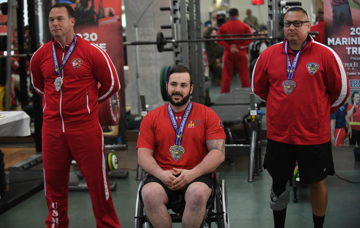 U.S. Marine Corps SSgt. Lawrence Guthrie (left), France Armed Forces Daniel Avon (middle), and Raymond Cardoza take home the gold, silver, and bronze medals, respectively, for the 97.01Kg-107Kg weight class during the 2020 Marine Corps Trials at Marine Corps Base Camp Pendleton, Calif., March 4. The Marine Corps Trials promotes recovery and rehabilitation through adaptive sports participation and develops camaraderie among recovering service members and veterans.