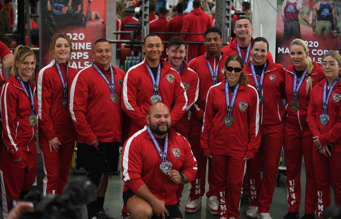U.S. Marine Corps Wounded Warrior Battalion West athletes gather to show the medals won during the 2020 Marine Corps Trials powerlifting competition at Marine Corps Base Camp Pendleton, Calif., March 4. The Marine Corps Trials promotes recovery and rehabilitation through adaptive sports participation and develops camaraderie among recovering service members and veterans.