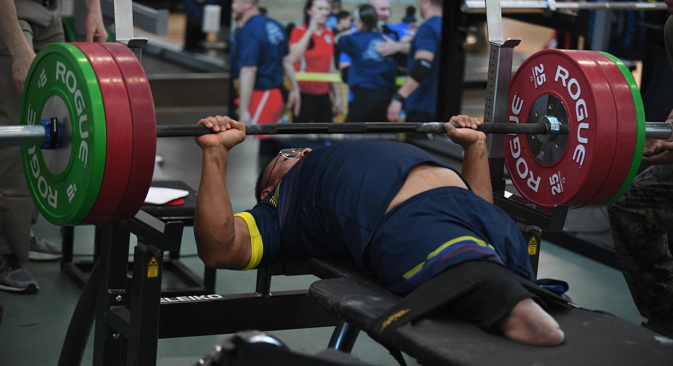 A recovering service member with the Colombian Armed Forces competes in the 2020 Marine Corps Trials powerlifting competition at Marine Corps Base Camp Pendleton, Calif., March 4. The Marine Corps Trials is an adaptive sports event involving more than 200 wounded, ill or injured Marines, Sailors, veterans and international competitors.