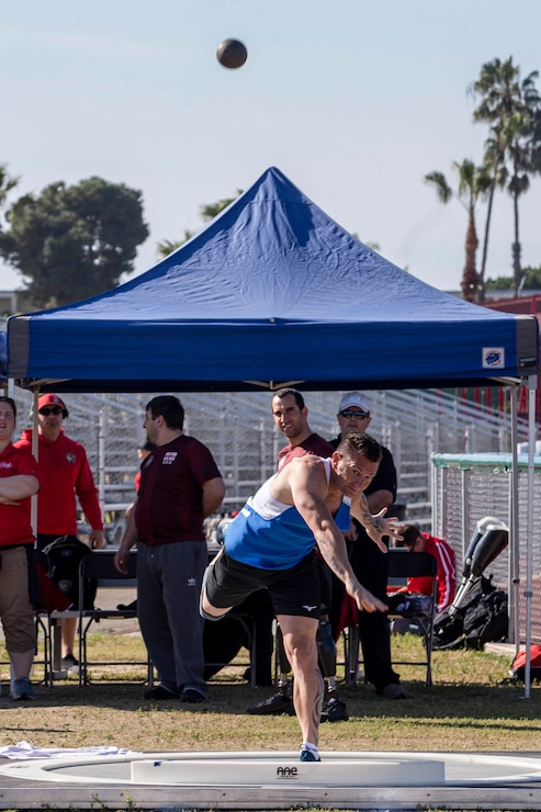 A service member from Team France throws a shot put during the 2020 Marine Corps Trials competition at Marine Corps Base Camp Pendleton, California, March 5, 2020. The Marine Corps Trials promotes rehabilitation through adaptive sports participation for recovering service members and veterans all over the world.