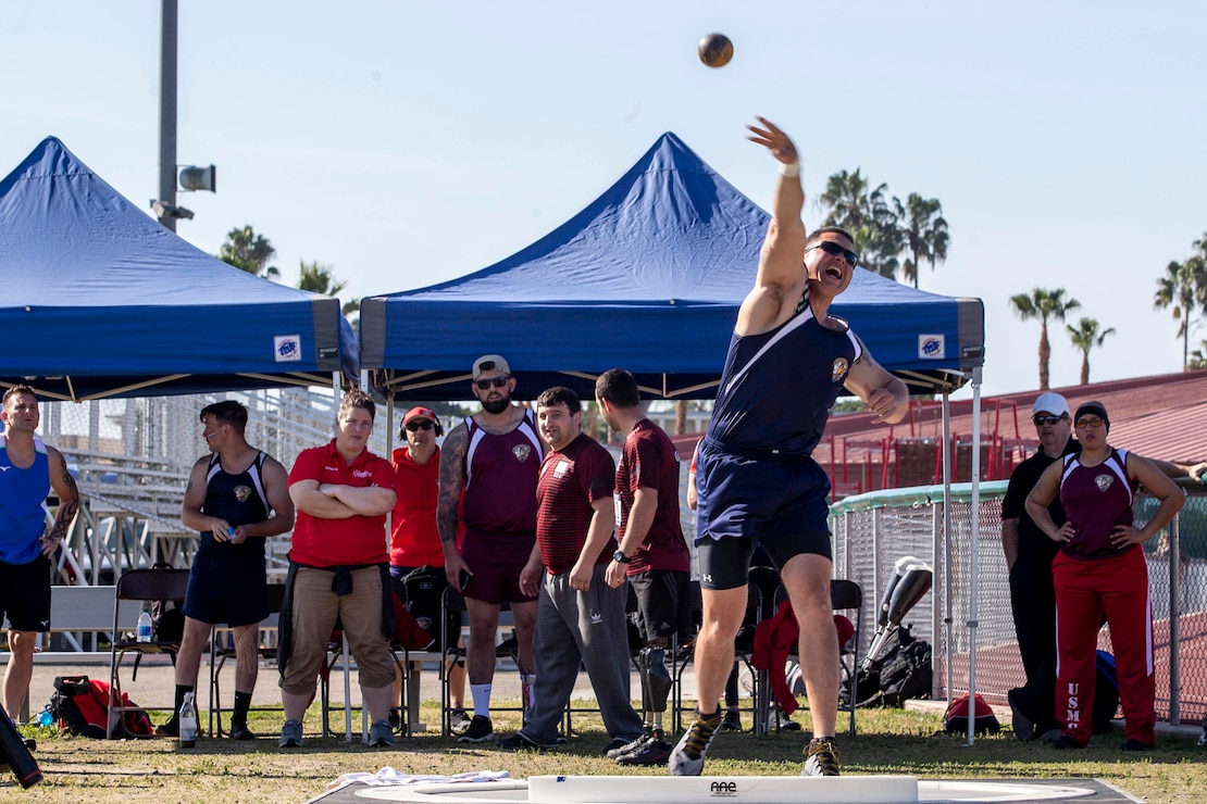 U.S. Marine Gunnery Sgt. Dorian Gardner, the Communication Strategy and Operations chief with Marine Corps Installations West, throws a shot put during the 2020 Marine Corps Trials competition at Marine Corps Base Camp Pendleton, California, March 5, 2020. The Marine Corps Trials promotes rehabilitation through adaptive sports participation for recovering service members and veterans all over the world.